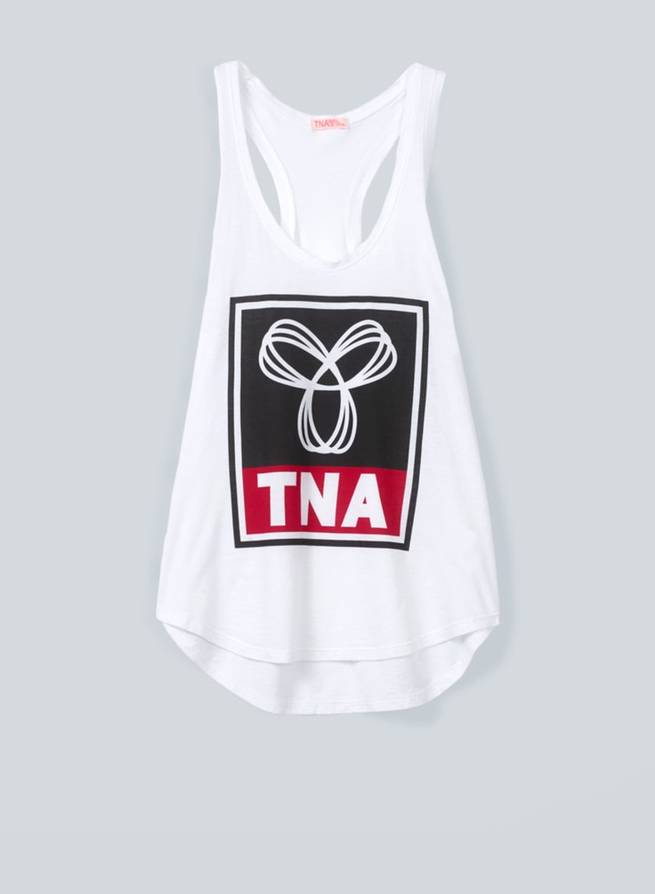 TNA Tola Tank—an ultrasoft, drapey tank with a custom logo graphic cute for summer with shorts or leggings