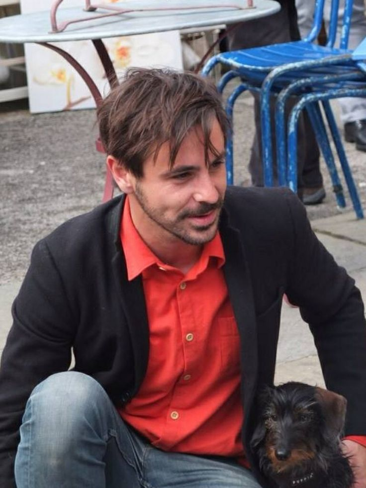 Emun Elliott, Actor from The Paradise, sitting on the pavement at Columbia Rd. Market London.