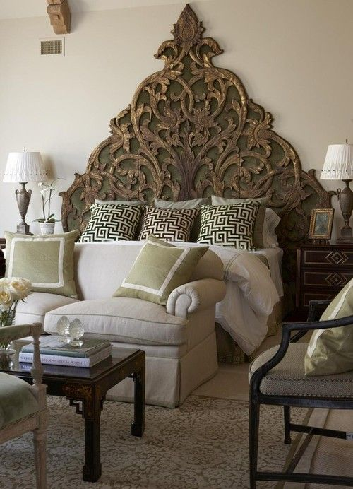 Using a couch as a footboard... Interesting use of furniture in this space. I don't hate it!