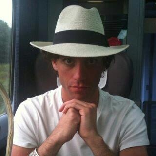 Mika in a hat