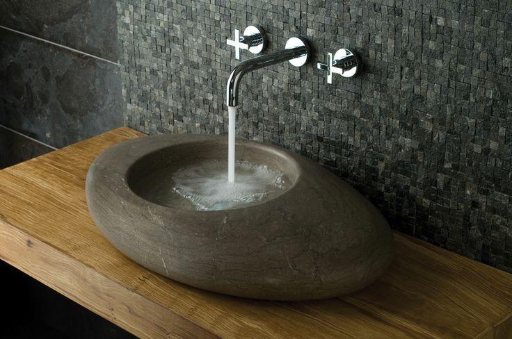 VADO Tonic wall mounted basin mixer, filling a stunning pebble basin in a beautiful organic inspired bathroom. www.vado-uk.com