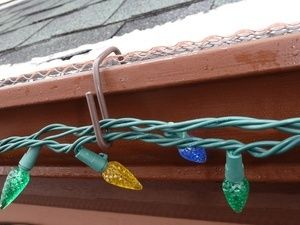 christmas hook is a christmas light hanger designed to fit gutters with mesh or perforated gutter guard - Christmas Lights Hangers