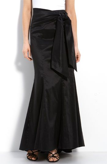 Love a classic black evening skirt. Wear it with a beautiful white white shirt or beaded tank. Maybe even an elegant cardigan set in seasonal colors. Always in style.