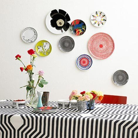 love love love this eclectic vintage plate collection for the wall