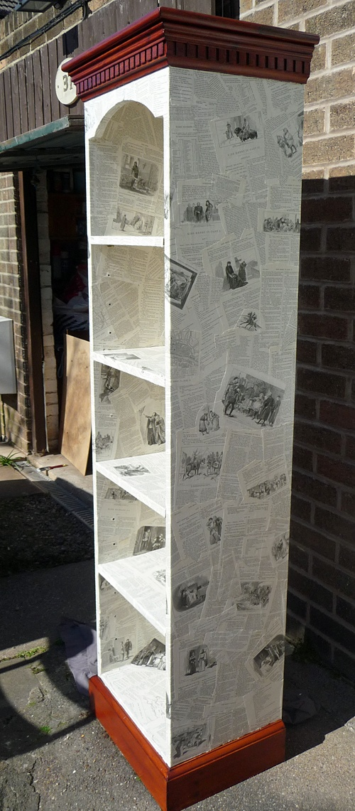Bookcase decoupaged using pages from Shakespeare plays, right side view. Created March 2012.