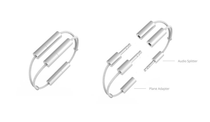 A functional bracelet that includes both audio splitter and plane adapter.