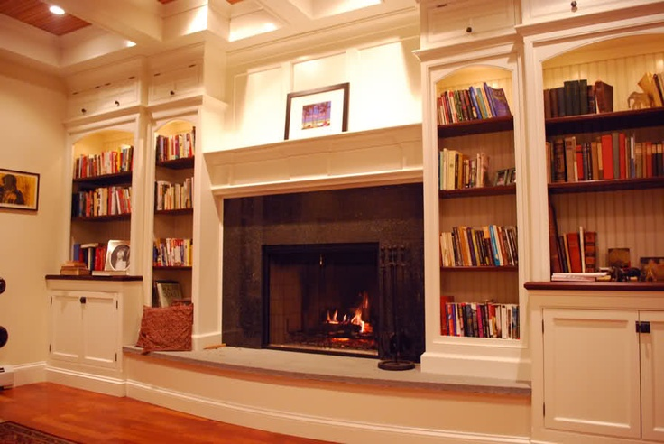 Love the raised fireplace - would want bookshelves that go to the ground on the left side - and on the right side of the fireplace, the TV with a nook on top and shelves below it. Would be cool to have a wood storage spot under the fireplace instead of empty space.