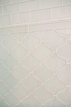 Bathroom design with elegant tile work using white glass subway tile and white…