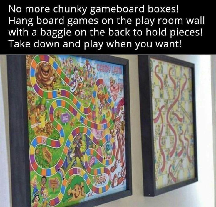Hang board games on the play room wall with a bag on the back to hold the pieces. Just take down when you want to play