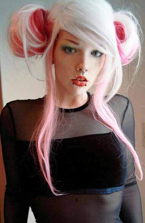 Love her hair. Wow that's a lot of piercings all clustered together.