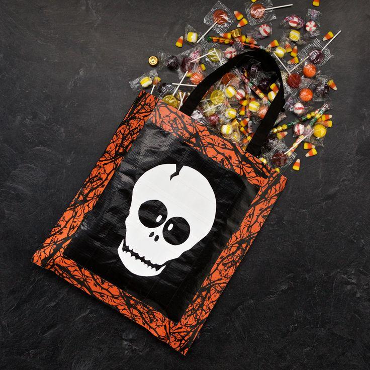 Printed Duck Tape® brand duct tape DIY trick-or-treat-bag. http://duckbrand.com/craft-decor/activities/trick-or-treat-bag?utm_campaign=dt-crafts&utm_medium=social&utm_source=pinterest.com&utm_content=duct-tape-crafts-halloween
