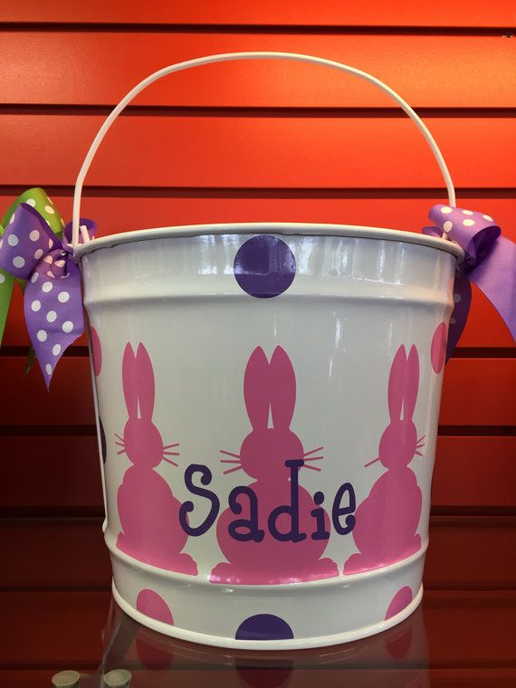 This adorable white metal bucket is perfect for Easter to use as an Easter basket, gift, or for your little one to use hunting for Easter eggs. Also a great gift to hold books and other small toys.  -- D E T A I L S -- Dimension: 9 inches high x 11 inches diameter/ 10 quart bucket Metal bucket Customized with outdoor waterproof vinyl Girl buckets with come with bows on the handle Order design as shown-- or custom designs available, message us for details.  --C H E C K O U T I N S T R U C...