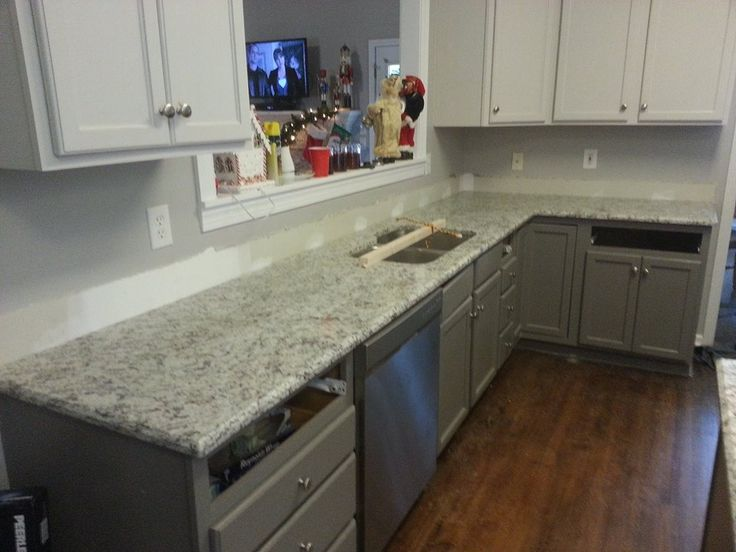 are finishing up their kitchen with a beautiful Ashen White granite