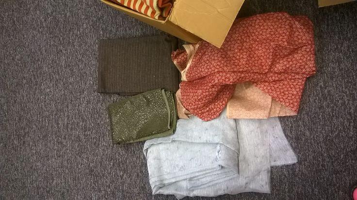 Our chosen fabrics strewn across the floor