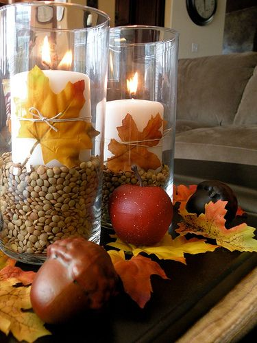 Use the hurricane vase from the Dollar Tree, white candles, twin/leaves, and some beans as the filler...so simple and inexpensive