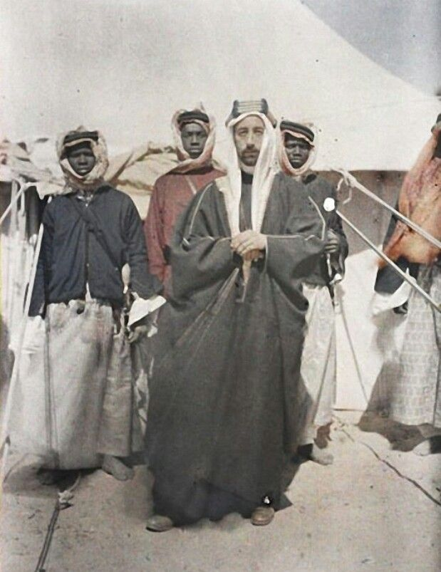 Amiir (Later Malik) Fayshal ibn al-`Hussayn al-Haa`shimii with His Sudanese Personal Guard During the Arab Revolt Against the Ottoman Empire (`Shaam) (1335s H Photograph; Republique Francaise) -Paul Castelnau (1297.6.7-1363.7.8 H Francais; Photographer) #FrenchRepublic #Jordan   Britain imported many African Warrior from Sudan to support the revolt against the Ottoman; composing large part of the army. Their decendant might have mixed with the Arabs of today