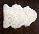 Sheepskin Rug, 2 x 3', Ivory  Remarkably soft and cozy; especially great for toddlers.  You'll loose your legos in a larger size; this is manageable.