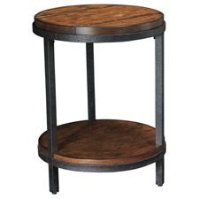 Baja Round End table is crafted of Poplar solids and Rustic/Distressed Ash veneers with a vintage umber finish. Transitional with simplistic lines, alluring metal and heavily distressed. Features one fixed shelf.