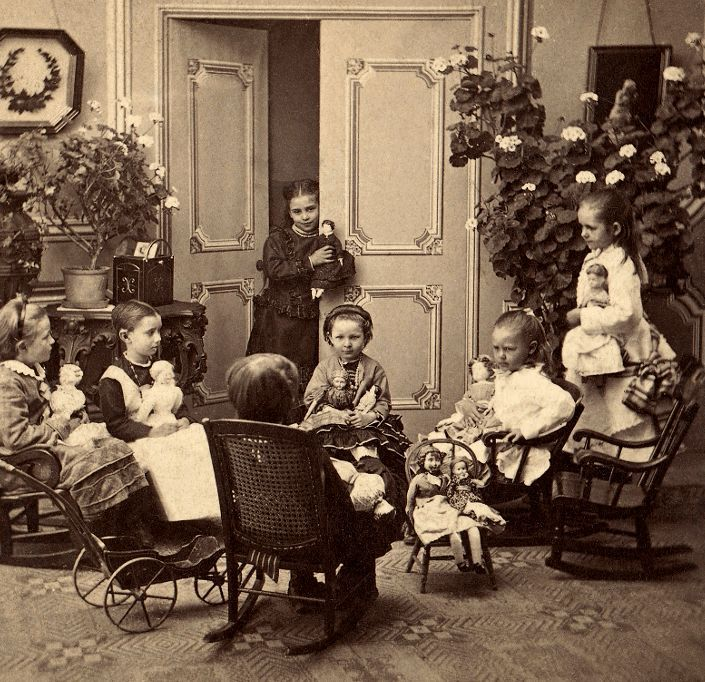 Victorian Girls Playing In The Parlor With Their Dolls