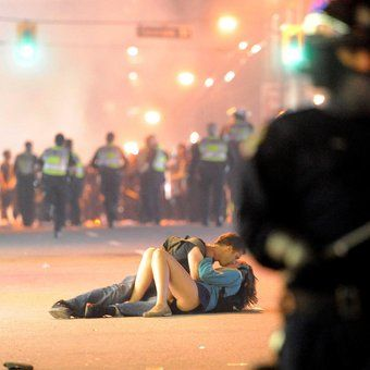 Kiss admist the Vancouver Riot.  Even with disaster there is beauty in Vancouver
