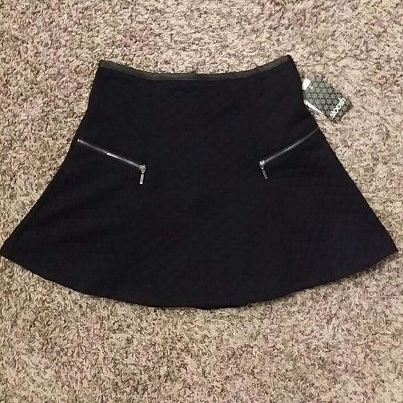 Black mini skirt Black flared mini skirt made with textured material (shown in picture) and decorative zippers on both sides of the front. Purchased at Macy's. Stoosh Skirts Mini