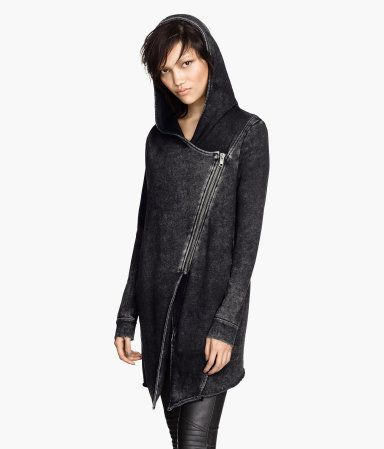 Cardigan in sweatshirt fabric with a lined hood, diagonal front zip, and side pockets. Raw edges at cuffs and hem.