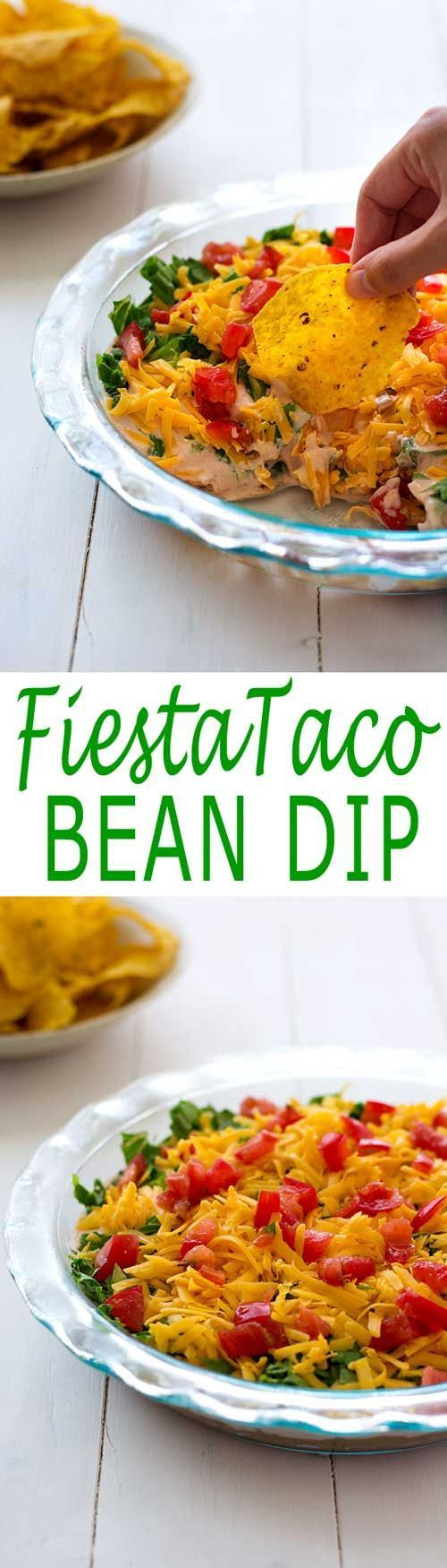 Fiesta Bean Dip layered with refried beans, salsa, sour cream, cheese, lettuce and tomatoes! | Kitchen Gidget