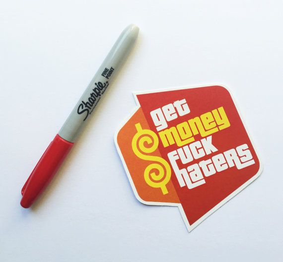Get Money Fuck Haters Sticker  This listing is for one high quality vinyl Get Money Fuck Haters Sticker sticker, for your laptop, car, truck, minivan, skateboard, mirror, window, binder, cat, dog, or whatever needs stickering.  Each sticker is approximately 5.25 x 2 inches, and in stunning full color as seen in the photograph.  These vinyl stickers are long lasting, color-fast, weather durable, look great on a variety of surfaces, and are easy to remove. This is a custom sticker, is cut out…