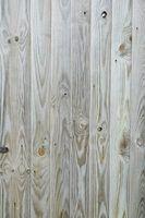 Whitewashing emphasizes the unsophisticated allure of knotty pine.