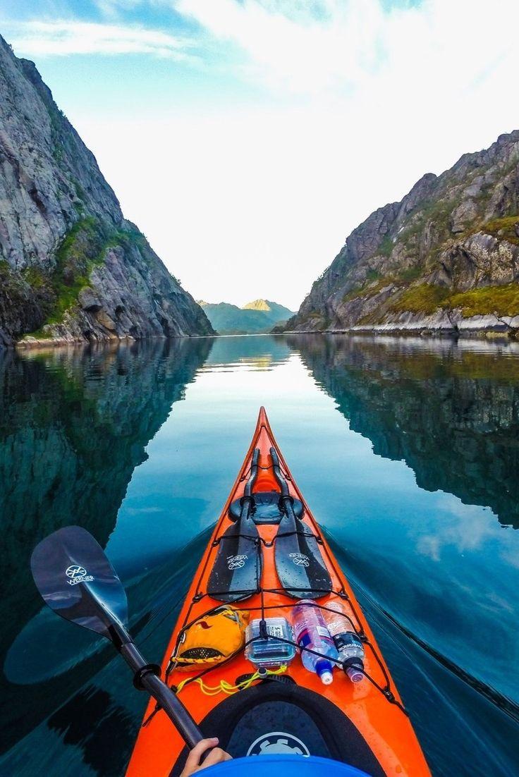 Kayaking in Trollfjorden, Lofoten Islands, Norway, during midnightsun by Tomasz Furmanek