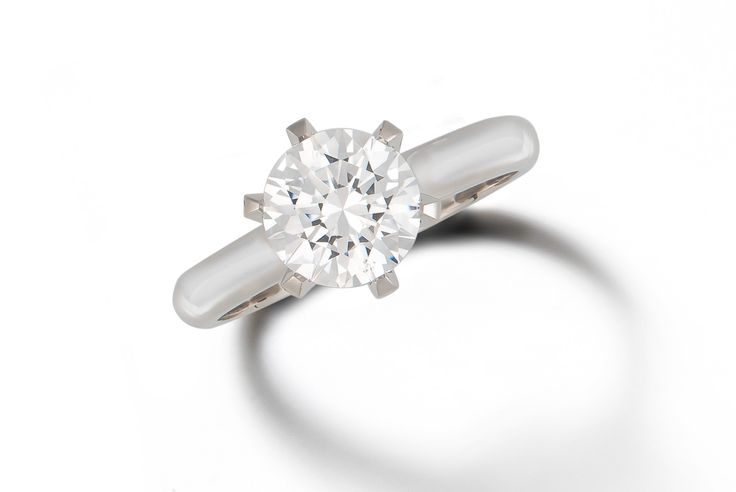 Solitaire round brilliant diamond engagement ring   with 6-claw setting in18ct white gold.