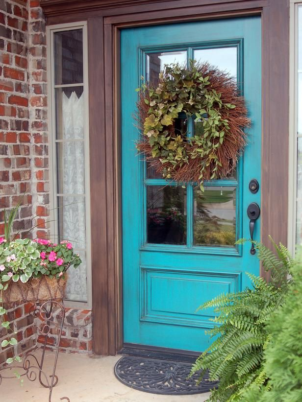 Awesome Front Door Colors that Symbolize Cheerful Characters : Inviting Turquoise Front Door Colors With Hanging Flower Brick Wall