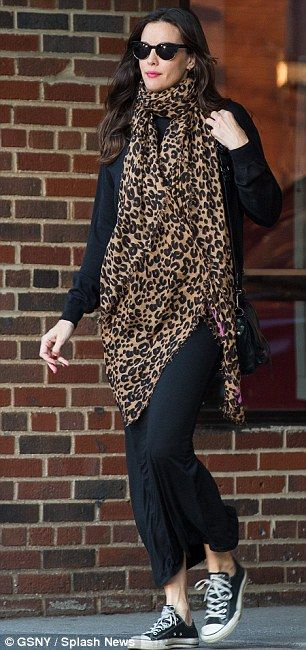 She's got it covered: The bump, if there is one, was hidden under a long, leopard-spot pri...