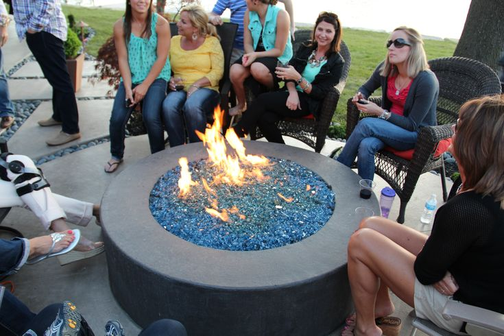 Schendel Lawn and Landscape's concrete fire pit with lava rock and fire glass. http://www.mycreativelawn.com/