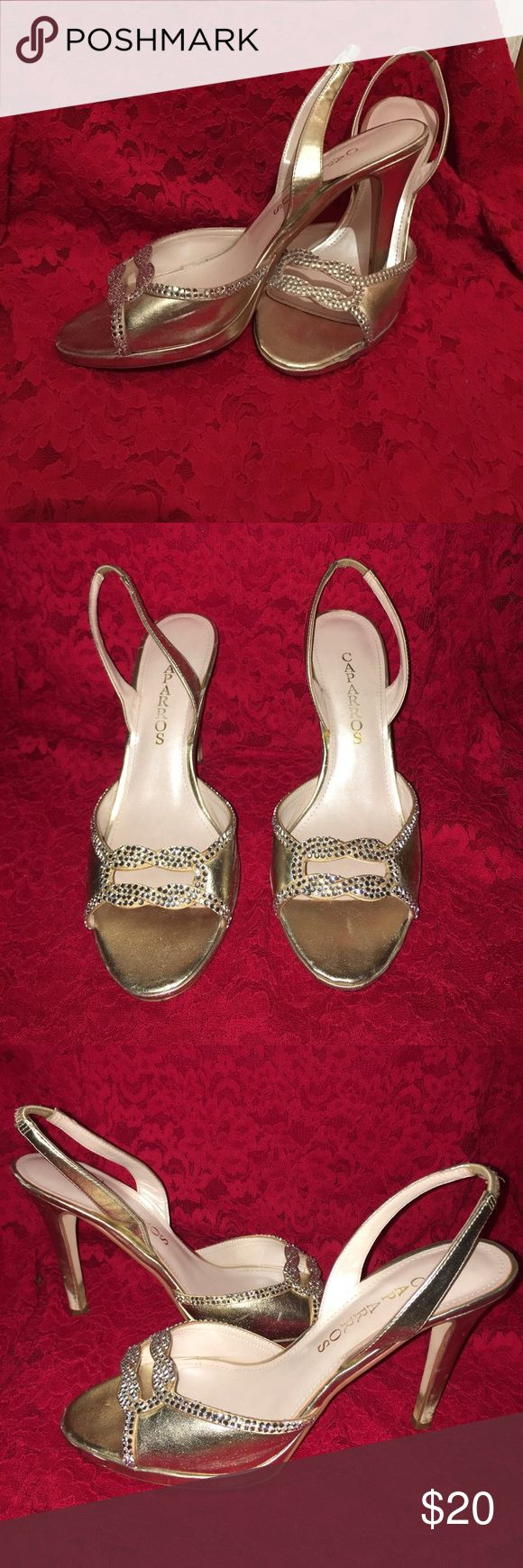 Caparros Gold and Rhinestoned Heels The heels are great for prom, a sweet sixteen, homecoming, a dance, or another formal event! These shoes have only been warn a handful of times but still in a great condition. On the  back of the heels the gold has been slightly warn away and there a couple scuffs as pictured. The band around the heel is still tight and intact. Caparros Shoes Heels