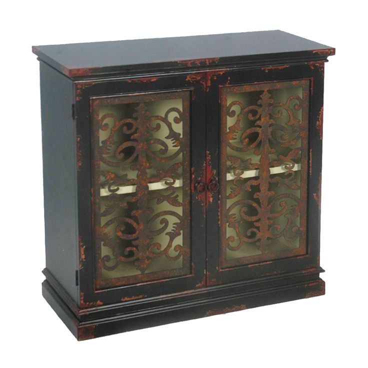 This distressed black finish accent chest features two functional doors for storage with a shelf inside. The chest offers antique brass finished hardware.