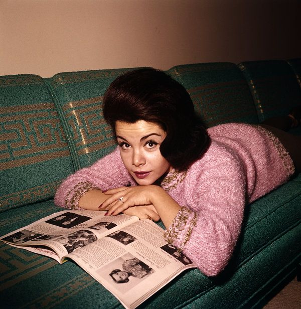 Is she looking at Teen Magazine?  I used to buy it JUST to see what Annette Funicello was up to and the beautiful pics.  I wanted to be her so badly!