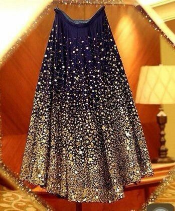 Navy blue lehenga with gold glitter all over looks stunning and ideal for your reception night | for more such ideas, keep your eyes on at wedfine.com |