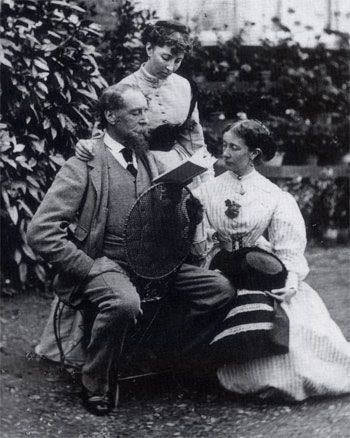 Charles Dickens reading to his daughters