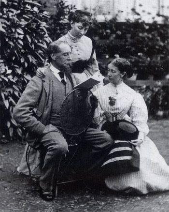 Charles Dickens leyendo.