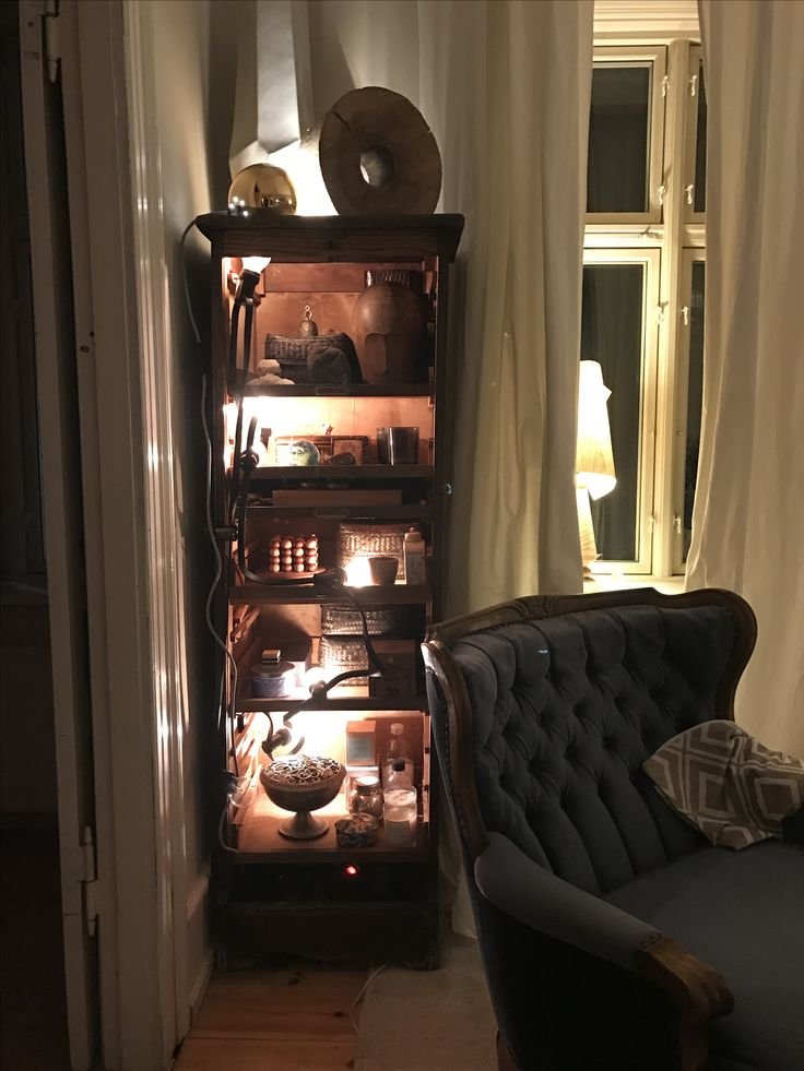 A stash of my most favourite little things are stacked in this cool old wood cabinet. Lit up by a House Doctor light chain.