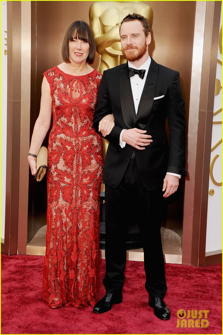 michael fassbender takes his mom to the oscars 2014 02 Michael Fassbender walks the red carpet with his mom Adele at the 2014 Academy Awards held at the Dolby Theatre on Sunday (March 2) in Hollywood.    The 36-year-old…