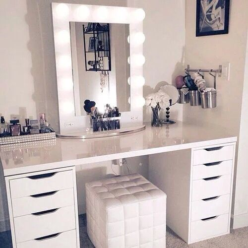 I love everything about this vanity set-up including the desk and metal cups on the wall to hold flat iron (both from IKEA)