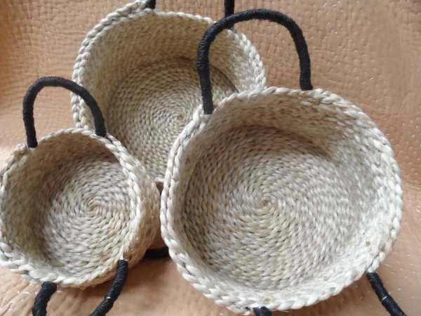 A divine eco-friendly basket which is ideal to use as a fruit/ vegetable basket, a sewing basket, a small toy basket, or for wherever you want to keep smaller items neatly organized. Shaped like little round pots with black handles The perfect home decor item for contemporary living.    Jute a natural fibre, obtained from the bark of the jute plant has remarkable strength and durability.