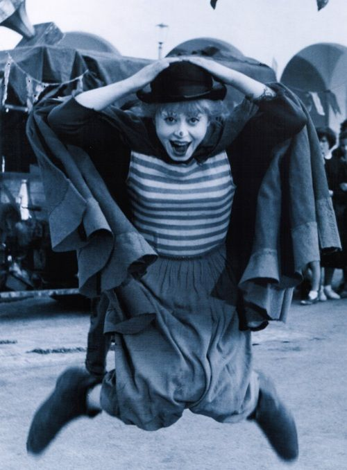 """Giulietta Masina on the set of La Strada (1954, dir. Federico Fellini) (via)    """"Mr. Fellini says that his wife sometime resists his view of her talents, which he summarizes as 'a mingling of youngish and clownish.' But make no mistake: in suggesting that his wife is a clown, Mr. Fellini means no insult. 'The clown is the aristocracy of acting,' he says. 'To be a clown means to have the possibility of making people cry and laugh.'"""