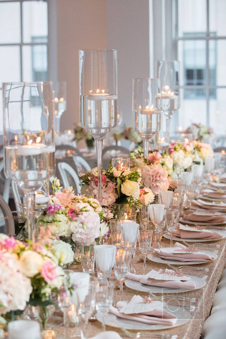 Blush flower arrangements and floating candles sat atop gold sequined linens. #tabledecor Photography: Christian Oth Studio. Read More: http://www.insideweddings.com/weddings/elaine-alden-and-landry-fields/589/
