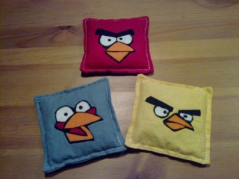Angry Birds bean bags for a throwing game. Faces are made out of felt and bags are filled with dried peas.