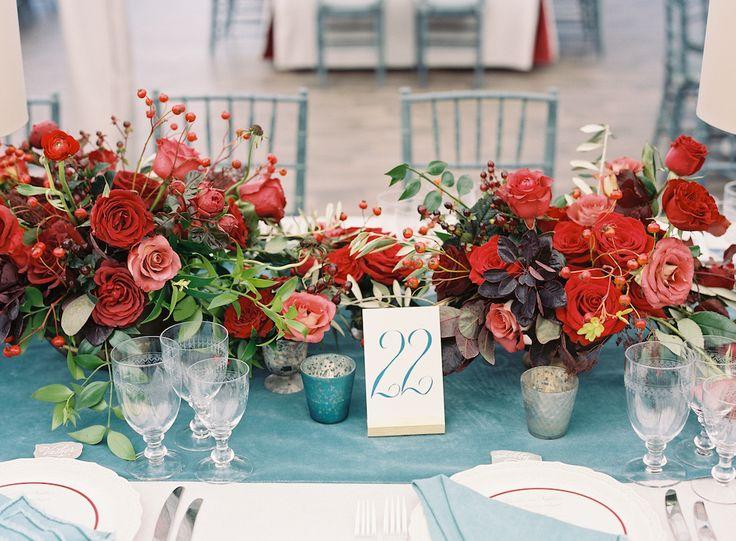 Crimson, salmon, and terracotta floral arrangements at a crimson + verdigris wedding with velvet details. photo: @tecpetaja | design: @calderclark | rentals: @snyderevents | flowers: @blossomsevents | #southernwedding #luxurywedding #plantationwedding
