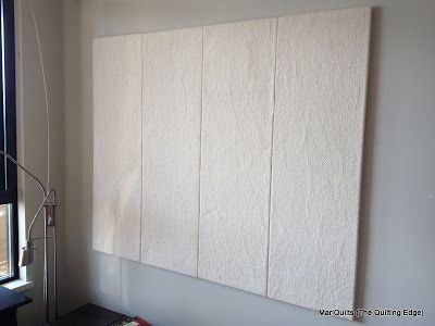 "Design Wall Tutorial; foam insulation board 3/4"" x 14 1/2"" x 48"", duct tape, Command strips; cotton batting, temporary fabric adhesive.  Use Flannel"