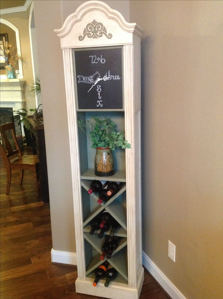 Grandfathers clock repurposed!   The most fun and creative project to date.   With an inexpensive clock that didn't chime correctly, and wanting a wine cabinet for a long time, one day it dawned us on ... Hey, we can do this!   DH stripped out the innards, and put his creativity to work, I did all the painting and color decisions!  Annie Sloan chalk paint always makes these projects easier.   I used Old Ochre and Chateau Gray, clear wax and dark wax, along with chalkboard paint for the…